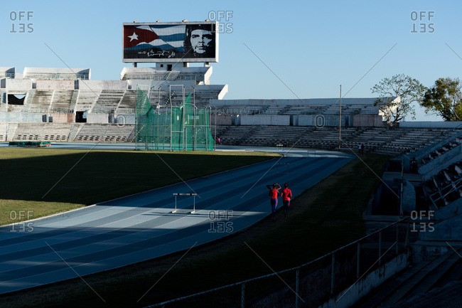 Cuba - March 7, 2016: Two people running on track field
