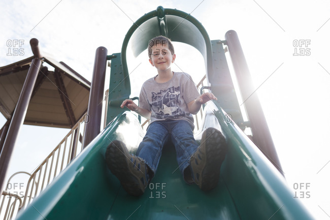 Boy at top of playground slide