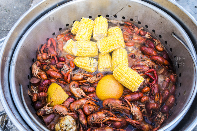 Overhead view of crawfish cooking in pot