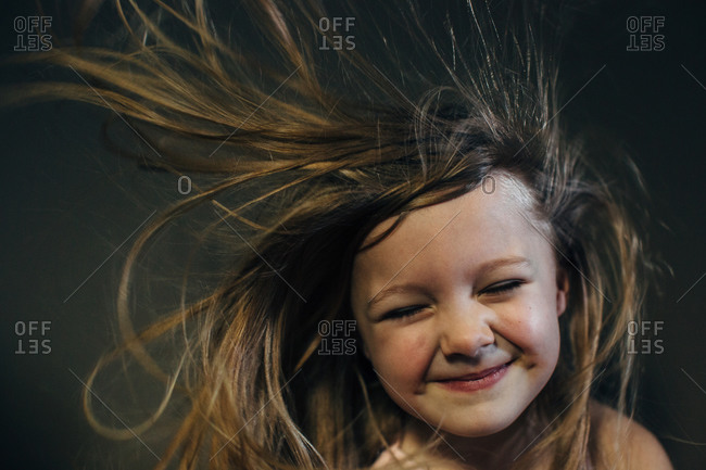 Smiling girl with windblown hair