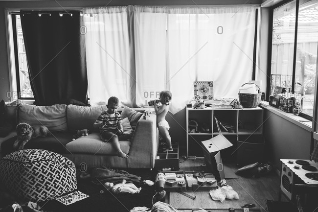 Children playing in a messy living room