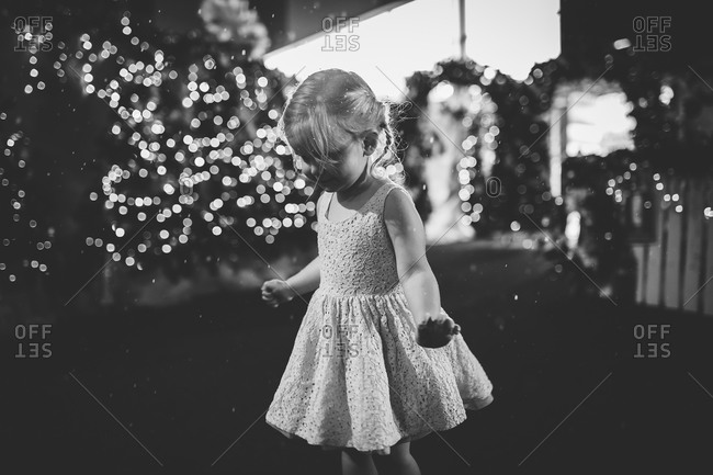 Portrait of a little girl outside at night