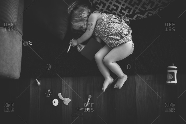 Little girl lying on the floor passed out