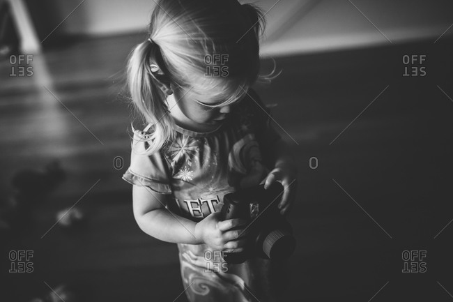 Little girl playing with a camera
