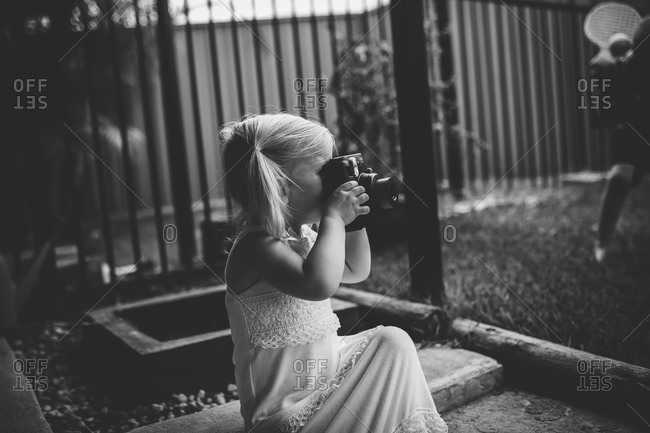 Little girl playing taking picture with a camera
