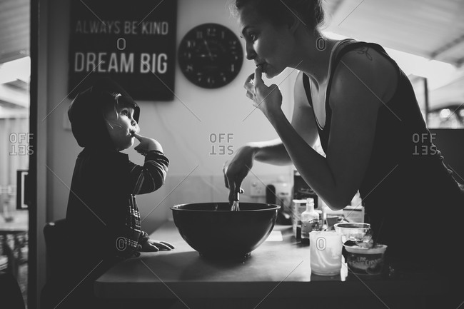 Woman baking with her little girl