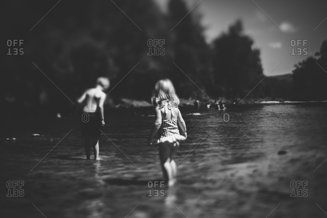 Children wading in a lake