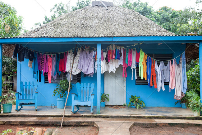 Clothing drying on a front porch clothes line