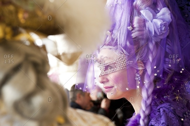 Venice, Italy - March 3, 2014: Woman dressed for Carnival