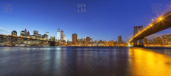 Manhattan skyline and Brooklyn and Manhattan Bridge at evening