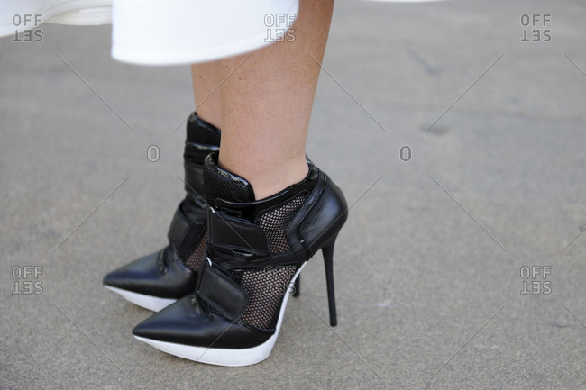 Woman in black and white sneaker stilettos