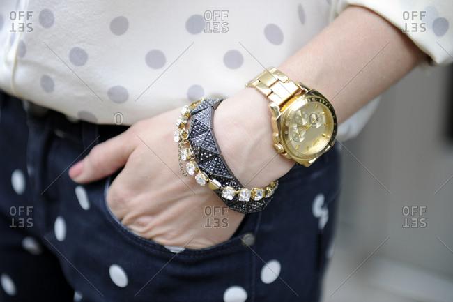 Woman wearing bracelets and a wrist watch