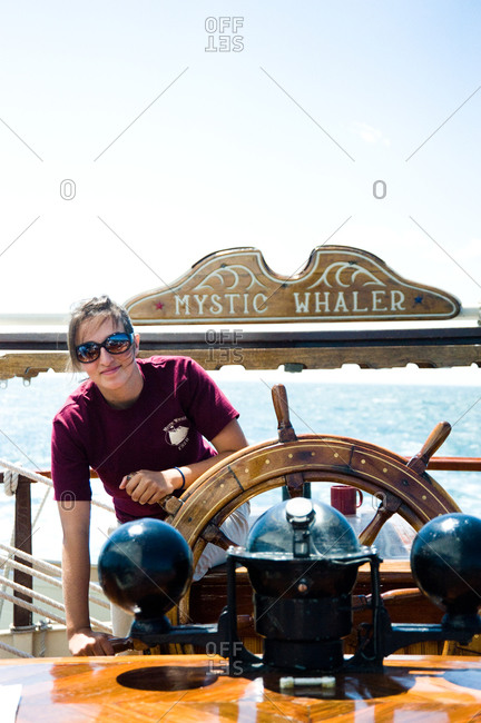Mystic, CT, USA - July 26, 2010: Female captain at the helm of the Mystic Whaler