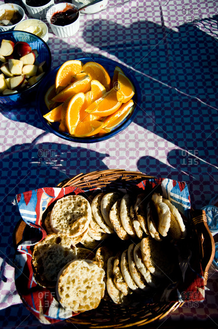 English muffins and fruit on breakfast table
