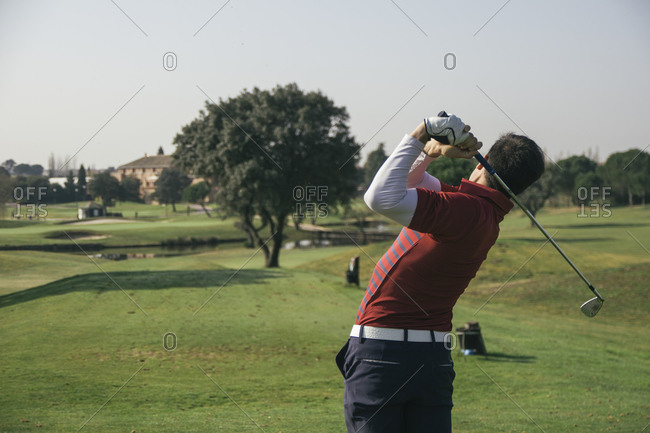 Golfer playing golf in a golf course
