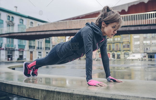 Mid adult woman doing outdoor workout