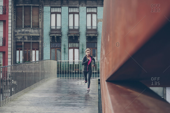 Mid adult woman running in the city