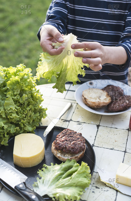 Boy's hands preparing hamburger - Offset
