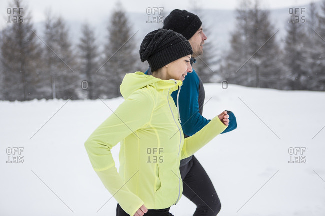 Couple doing cross country run in winter