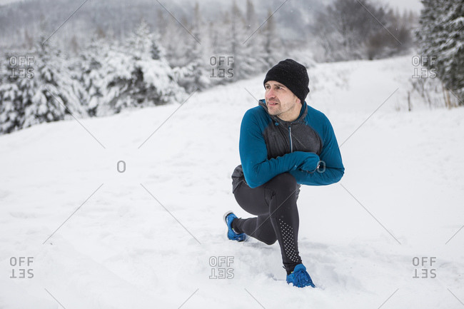 Man warming up for cross country run in winter