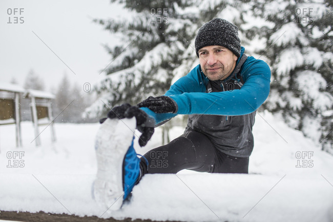Man warming up for a run in winter