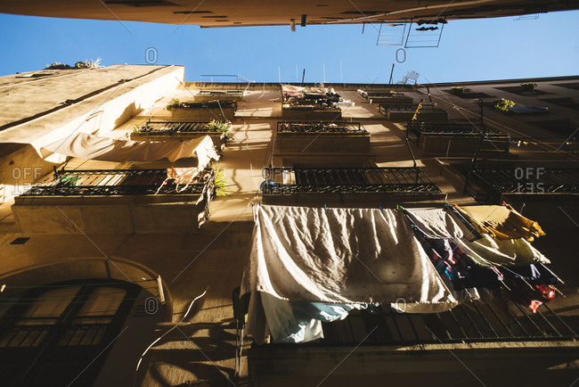 Spain, Barcelona, house front with drying clothes at the Gothic Quarter