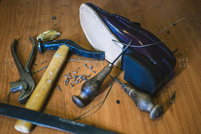 Shoemaker's tools and a new leather shoe