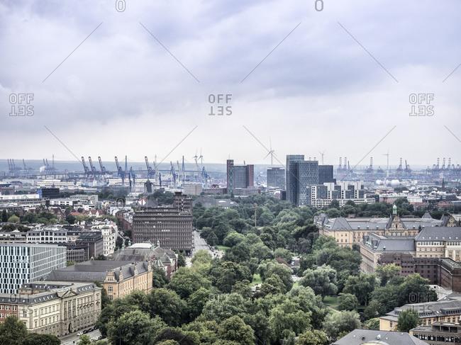 Germany, Hamburg, cityscape with Koehlbrand bridge and harbor cranes