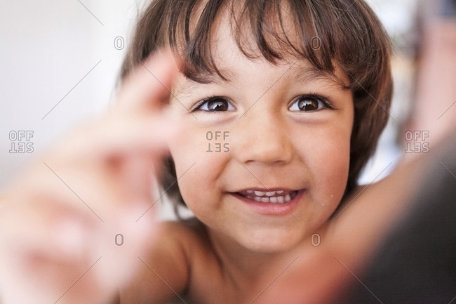 Portrait of smiling little boy with brown eyes