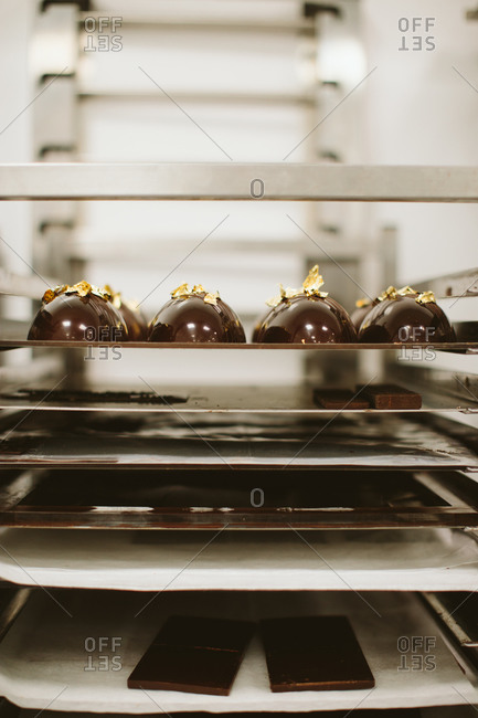 Trays of chocolate confections drying in kitchen