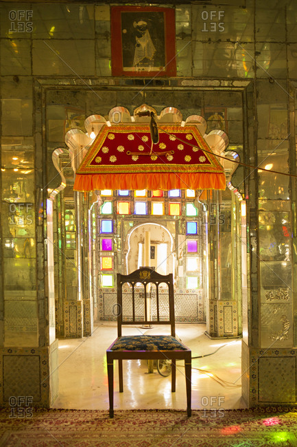 Udaipur, Rajasthan, India - January 17, 2014: Chair in the stained glass room of the City Palace, Udaipur