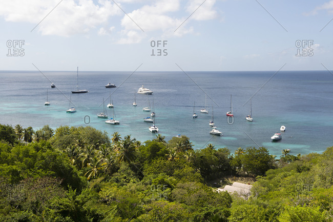 Sailboats in the water on the coast of Mustique Island