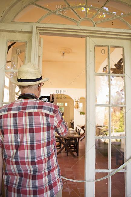 San Francisco de Paula, Cuba - January 25, 2016: Tourist taking picture of room in Hemingway's House at Finca Vigia