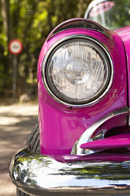 Headlight on a pink vintage