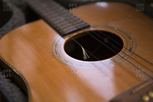 Close up of an old acoustic guitar