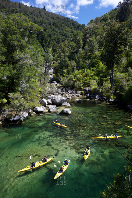 Kayakers in a New Zealand river