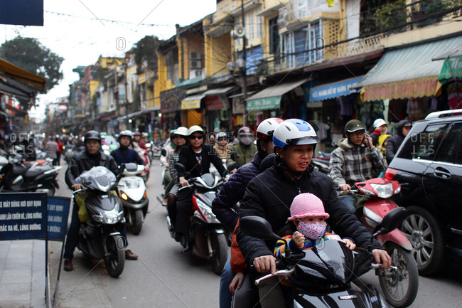 Hanoi, Vietnam - March 10, 2012: Scooter traffic, Hanoi, Vietnam