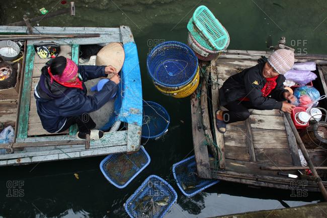 Ha Long Bay, Vietnam - March 11, 2012: Local vendors in Ha Long Bay, Vietnam