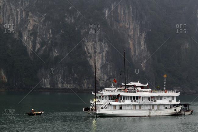 Ha Long Bay, Vietnam - March 11, 2012: Two boats in Halong Bay, Vietnam