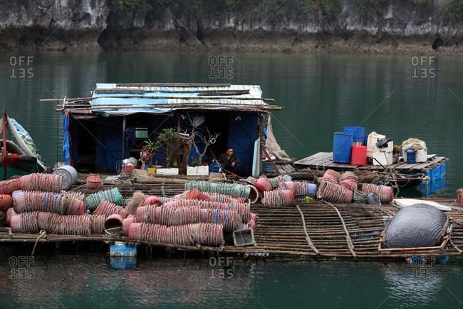 Ha Long Bay, Vietnam - March 12, 2012: Floating fishing village, Ha Long Bay, Vietnam
