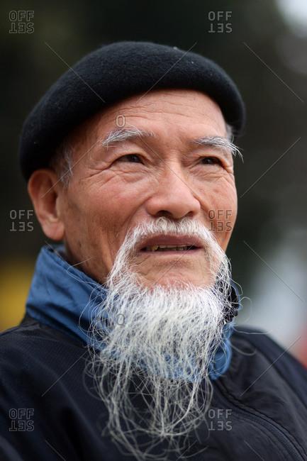 Hanoi, Vietnam - March 14, 2012: Portrait of elderly Vietnamese man