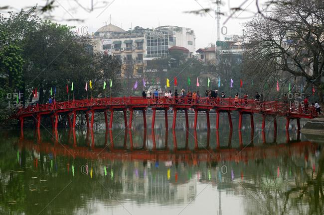 Hanoi, Vietnam - March 14, 2012: People on Huc Bridge, Hanoi, Vietnam