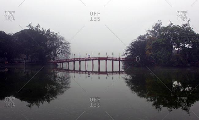 Bridge reflected in lake, Vietnam