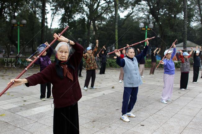Hanoi, Vietnam - March 18, 2012: Elderly women exercising, Hanoi, Vietnam