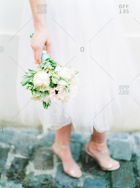 Bride holding a pastel-colored wedding bouquet