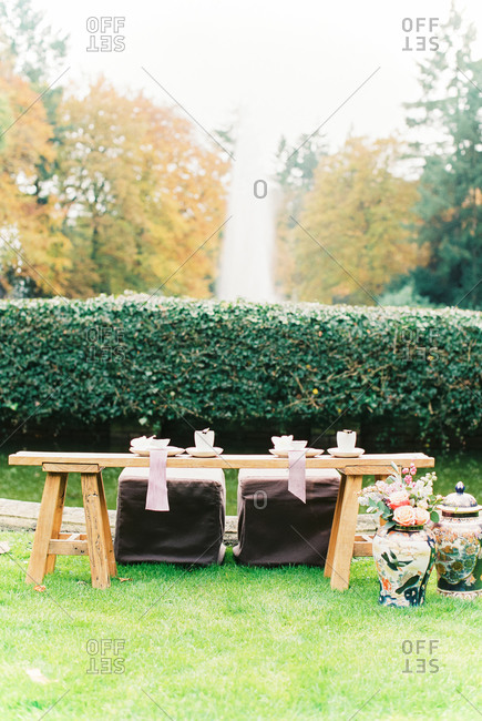 Asian-style sweetheart table set in garden