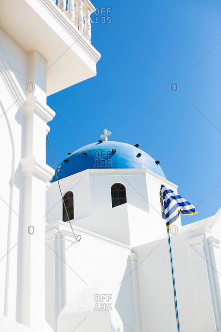 Low angle view of a blue-domed church in Santorin, Greece