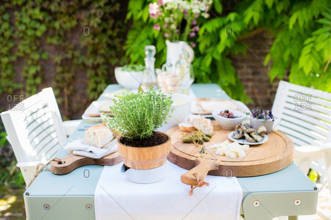 Italian snacks and herbs on al fresco dining table