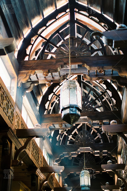 Lanterns hanging from wooden beams in a Middle Eastern market