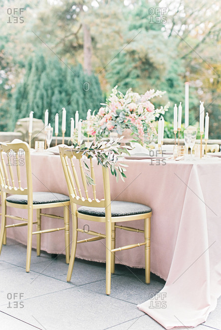Pink and gold decorated dining table with chair decorated with olive branch